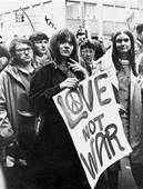 Hippies Holding Love Not War sign Courtesy of Moral Journey